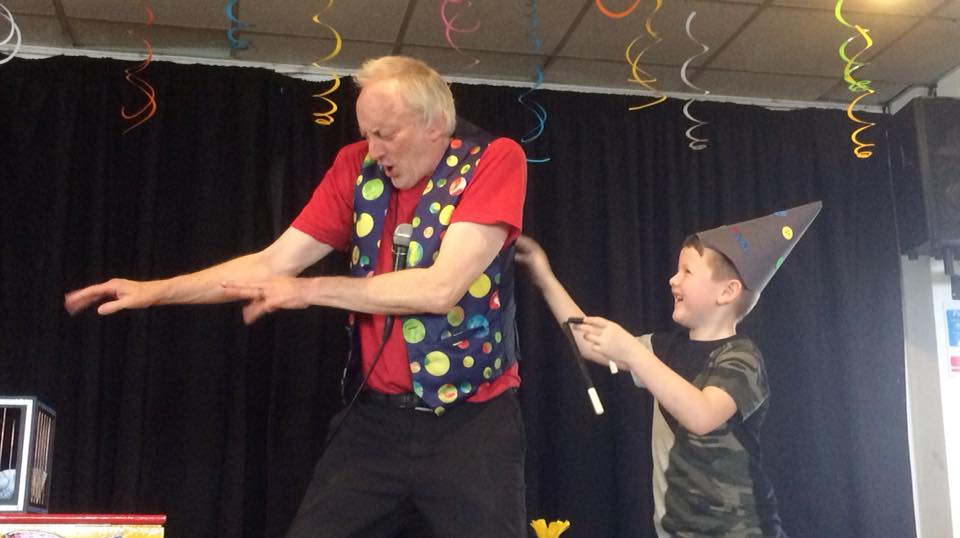 Micky the Magician on Stage at London Magic Show